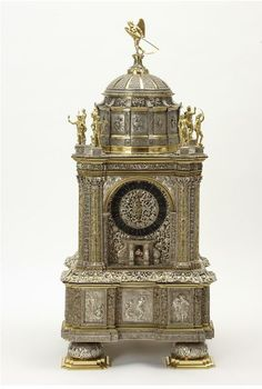 Clock Place of origin:The Hague (made) Date:ca. 1665-1670 (made) Artist/Maker:Breghtel, Hans Conraedt (designer and maker)  van den Bergh, Adriaen (movement, maker) Materials and Techniques:Silver and silver-gilt, pierced, embossed, filigree
