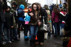The Shooting at Sandy Hook: A mother holds her daughter near Sandy Hook Elementary School, the site of a mass shooting that took the lives of 20 children and six adults on December Contemporary History, Iconic Photos, Photojournalism, Sandy Hook, 21st Century, Elementary Schools, Pop Culture, The Past, In This Moment