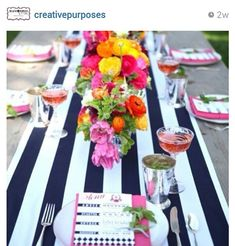 Black and white stripe table runner ...bright floral centerpiece with hot pink accents