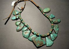 Millicent Rogers Museum - Single strand necklace of turquoise and stone disc beads. Native American ca.1940s.