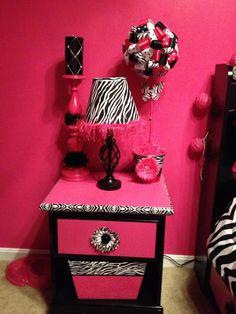 Zebra and Pink Night Stand.. Black spray Paint $2,lamp & shade Dollar Store $8, new drawer pull and flower $2, Zebra Duck tape Trim $5.