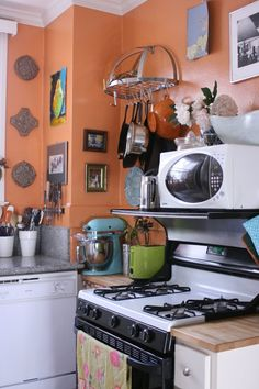 """Robert's """"I Love Orange"""" Room room for color contest - pot rack and shelf over stove to hold microwave Apartment Kitchen, Apartment Living, Apartment Ideas, Kitchen Dining, Kitchen Decor, Kitchen Display, Kitchen Ideas, Orange Rooms, Orange Walls"""