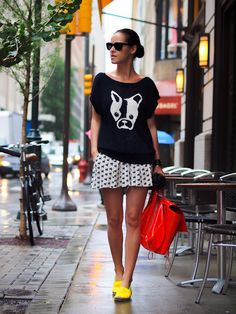 What I love here: 1. The Combination of skirt/full shorts with a chunky sweater. 2. A Neutral outfit with bright shoes. 3. The casual aspect.