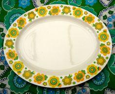 Retro Flower Power Ceramic Serving Platter Big Yellow and Green Flowers. £19.99, via Etsy.