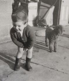 60's boy with pet poodle