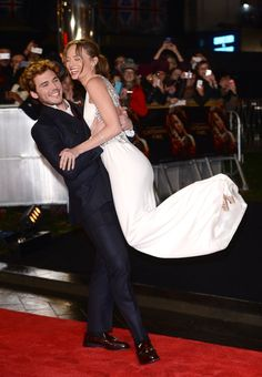 Pin for Later: Sam Claflin and Laura Haddock Are the Cutest Red Carpet Couple Ever When He Swept Her Off Her Feet!