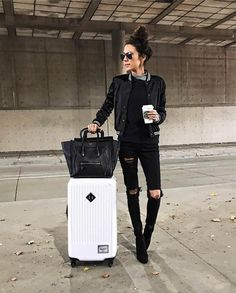 Insta Roundup | Hello Fashion. Grey turtleneck top+black sweater+black ripped denim+black boots+black bomber with white details+black tote bag+white suitcase+black sunglasses. Fall Travel Outfit 2016
