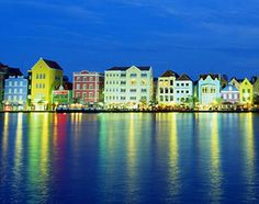 The charming, pastel-colored Dutch shophouses lining waterfront Handelskade are Willemstad's signature image.  And what a sight at Night!