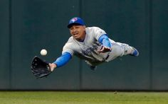 Toronto Blue Jays center fielder Ezequiel Carrera makes a diving catch to rob Minnesota Twins' Trevor Plouffe of a hit in the fourth inning of a baseball gamein Minneapolis.