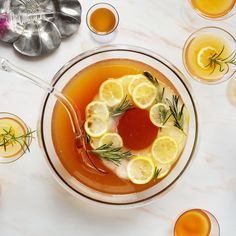 Turn this Earl Grey tea and bourbon punch recipe up a notch with a decorative ice ring. Bourbon Punch Recipe, Tea Punch Recipe, Punch Recipes, Drink Recipes, Yummy Recipes, Recipies, Thanksgiving Cocktails, Christmas Cocktails, Thanksgiving Recipes