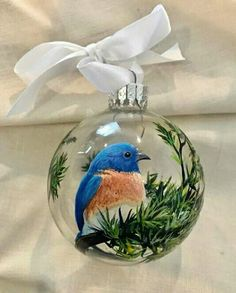 Best 12 Blue Bird Christmas Tree Ornament Hand Painted Glass Green Pine Sphere Woodland Great Outdoors Unique Holiday Gift This sweet little blue bird hanging out in a bed of pine needles is an unique, rustic and beautiful ornament that will make a big i Christmas Tree Painting, Painted Christmas Ornaments, Hand Painted Ornaments, How To Make Ornaments, Christmas Balls, Glass Ornaments, Christmas Fun, Christmas Decorations, Woodland Christmas