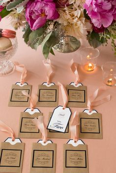 These lovely escort cards are easy to make with Avery printable tags, brown paper sleeves, kraft brown square labels and some pretty ribbon or twine.