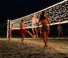 Careful not to hit the gorgeous net! Fun christmas activity only if it's not cold! #christmas #holiday This just looks so cool! Christmas light volleyball!