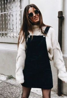 A winter look. Layer a sweater with a overall skirt/dress