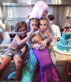Family time: Khloe Kardashian posted a photo of North and Penelope - both dressed in mermaid costumes - with Mason during their joint birthday party last month