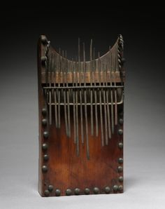Africa | Thumb piano.  Bushoong peoples, DR Congo | ca. 1900s | Wood and metal.