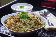 Keema Biryani: a fabulous street food of Mumbai, made with fragrant minced lamb or goat flavored in aromatic spices and then cooked with scented basmati rice in a dum preparation.