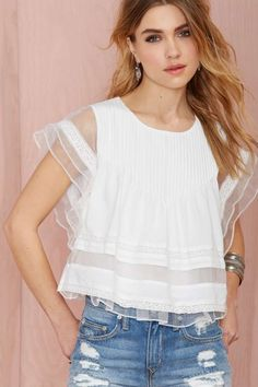 Spring / Summer - street chic style - beach style - white pleated and ruffled top with organza and crochet inserts + ragged light denim shorts