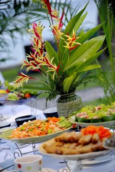 This Thai wedding has a very beautiful reception banquet spread. Look at the delicious food and beautiful flowers!