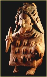 Elegant naturalistic Chone style Jamacoaque figurine. This individual sits on his buttocks, knees bent in front. He holds a round poporo (lime pot) in one hand and a spatula in the other.