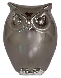 Let this charming Chrome Owl Figurine brighten up your home with its decorative appeal. Display this figurine in your home office, kitchen or bathroom.   Crafted of plated ceramic.   Silver chrome finish. $12