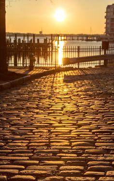 A cobblestone road during sunset in the Freemason neighborhood in Norfolk, VA.