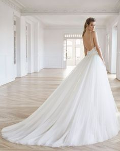 Princess-style wedding dress in beaded lace. Deep-plunge neckline and low back with detachable tulle train. Available in natural. Bridal Collection, Dress Collection, Vera Wang, Wedding Dresses Pinterest, Princess Style Wedding Dresses, Bridal Reflections, Poses, Bridal Looks, Beaded Lace