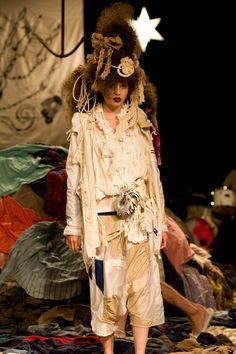 fur fur SS 2010.  Love the rag strewn runway!  If Vivienne Westwood was Japanese....