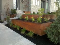 Natural Rust Finish Steel Planter and Retaining Wall - my only worry that it not ruin other materials nearby (from the rust) http://www.outdoorelementsutah.com