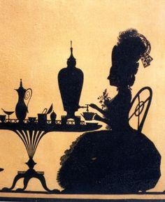 Silhouette of woman taking tea