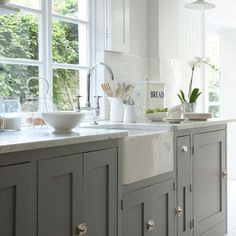 grey cabinets and farmhouse sink.I will have a farmhouse sink! Grey Kitchen Cabinets, Kitchen Redo, Kitchen And Bath, New Kitchen, Grey Cupboards, Shaker Cabinets, Kitchen Units, Base Cabinets, White Cabinets