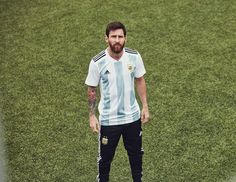 21766d8a4 nice Messi wearing Argentina s new world cup jersey Lionel Messi