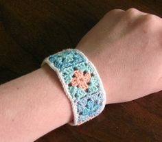 Pattern: crochet granny square bracelet with snap. Her wrists are very small, but mine are huge, so I imagine I will make one twice this size.