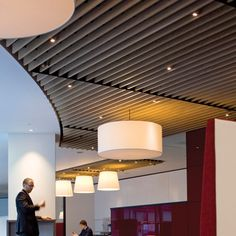 The recent fit out of the new PWC headquarters on the More London complex on the South Bank of the river Thames, has included the specification of a solid wood grill ceiling from Hunter Douglas.