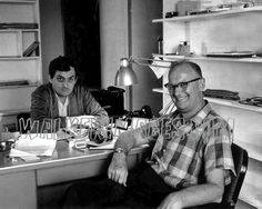 Stanley Kubrick (behind the desk) and Arthur C. Clark, in Kubrick's office.  (2001 a space odyssey.)
