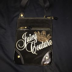 Cross body Juicy Couture purse Velvet black juicy couture cross body. In perfect condition! Leather and stitch accents. Adjustable length. Two main pouches, with little pockets in the inside. Juicy Couture Bags Crossbody Bags