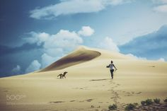 havin a good time havin a good time by...  yellow sky girl travel dog sand running fun dramatic adventure golden retriever bruneau sand dunes p
