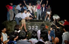 Civilians hold rocks as they stand on a government armored vehicle near Chang'an Boulevard in Beijing, early on June 4, 1989. Violence escalated between pro-democracy protesters and Chinese troops, leaving hundreds dead overnight. (AP Photo/Jeff Widener) #