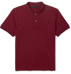 Prada's polo shirt is made from a lightweight cotton-piqué in sleek slim fit. It's detailed with a triangular emblem - a simplified take on the Italian label's trademark metal plaque. The burgundy hue is a sophisticated choice and works with everything from pale chinos to dark denim.