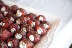 Bridal Shower Food; strawberries filled with cheesecake filling and drizzled with chocolate.  Delish!
