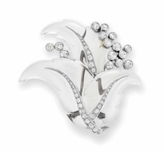 ROCK CRYSTAL AND DIAMOND 'FEUILLAGE' BROOCH, BY SUZANNE BELPERRON  Of foliate design, the carved rock crystal leaves enhanced with old-mine cut diamonds, to the old European-cut bezel-set diamond cluster detail, mounted in 18k white gold, with French assay mark and maker's mark, circa 1950 With maker's mark of Groené et Darde for Suzanne Belperron