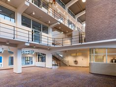 Netherlands Aerospace Centre, Amsterdam #renovation #officeinterior #entrance #bricks #tiles