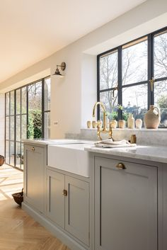A classic combination; Carrara marble worktops, a beautiful big Belfast sink and deVOL's Aged Brass taps