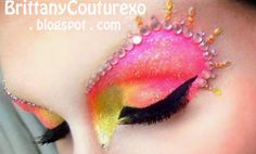 "Colorful pink and yellow shimmery eye shadow with a crystal brow and accents, titled ""Glitzy Glamour""."
