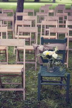 wedding memory chair for those who have passed. I love this idea. Maybe with a picture as well as the flowers. I also love that the chair is a different color to draw attention to it