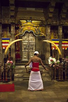 The drummer calls evening puja at Sri Dalada Maligawa (Temple of the Sacred Tooth Relic), Kandy, Sri Lanka.
