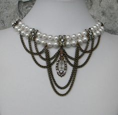 A unique Victorian style dainty pearl choker necklace and earring set, beautiful contrast with antiqued brass and white combination, $85.00 https://ericascreativecavalcade.com/products/white-and-brass-victorian-choker-set-ericas-creative-cavalcade