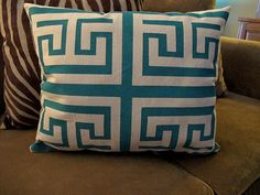 DIY patterned pillows using screen print paint & tape - apparently screen print paint works better than fabric paint (good to know!).