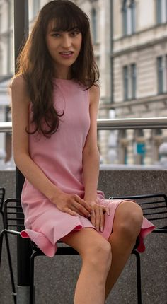 Fashion Blogger Veronika Lipar of Brunette from Wall Street sharing how to wear peachy pink cocktail dress for cocktail party #partydress #partystyle #businessparty