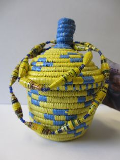Happy Monday Everyone! We have paired a cute little blue and yellow basket with a paper bead necklace that the Grandmothers of Nyaka made for only $18. Check out our Etsy store for other color combinations too!